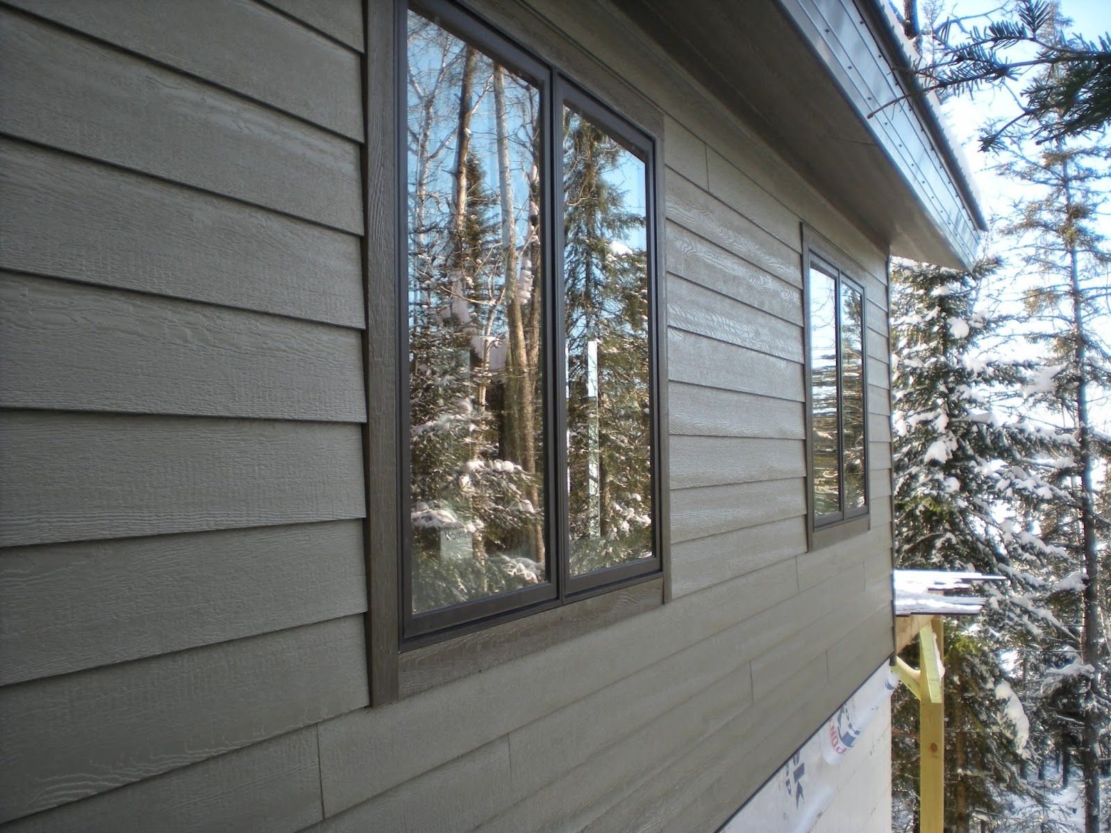 Lp smartsiding huisman custom homes timber frame ely for Lp smartside board and batten