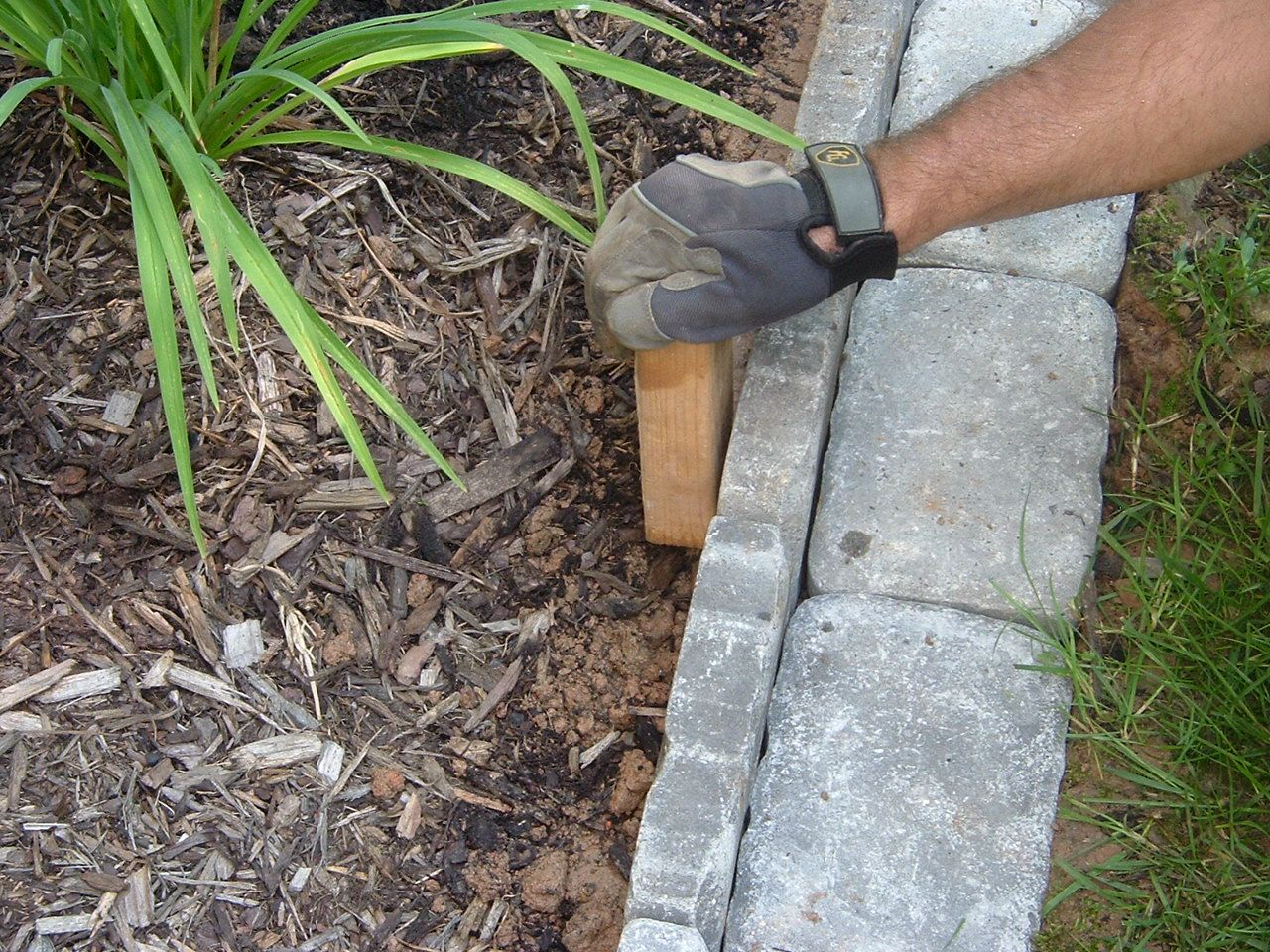 Great way to edge flower beds! The flat cobblestones in front, the ...