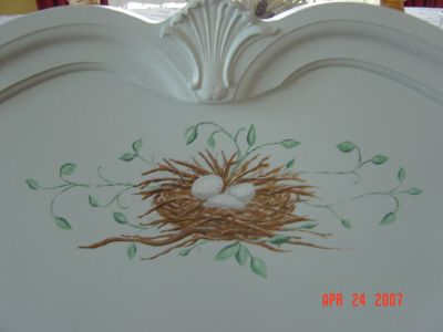This bed was in someone's basement.  I painted it a beautiful soft robin's egg blue and painted a nest on the headboard.