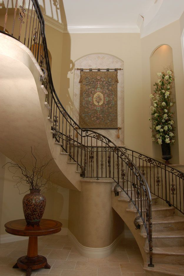 Elegant Staircase In The Foyer Of This Home Spanish Mediterranean