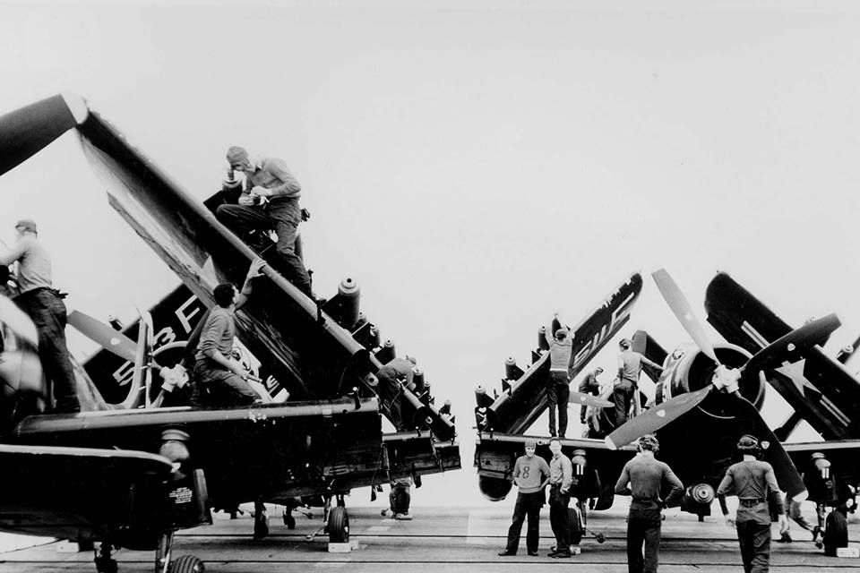 Ordnancemen at work on AD Skyraiders of Attack Squadron (VA) 45 on board the carrier Lake Champlain (CVA 39) off the coast of Korea on June 20, 1953, sixty years ago today.