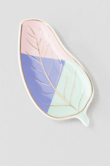 """The Pastel Leaf Trinket Tray is the perfect gift for your mom or bestie! The vibrant colors& gold accents add special touches to this ceramic piece. Pair with our additional home & gift options for a complete look.<br /> <br /> - 3"""" x 5.5""""<br /> - Pastel body<br /> - Gold accents<br /> - Ceramic<br /> - Imported"""