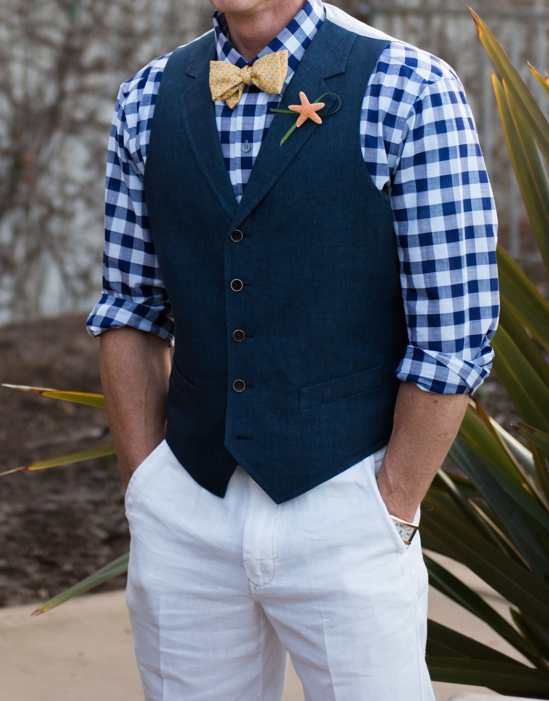 Beachy Gatsby wedding outfit with bowtie, vest, rolled up