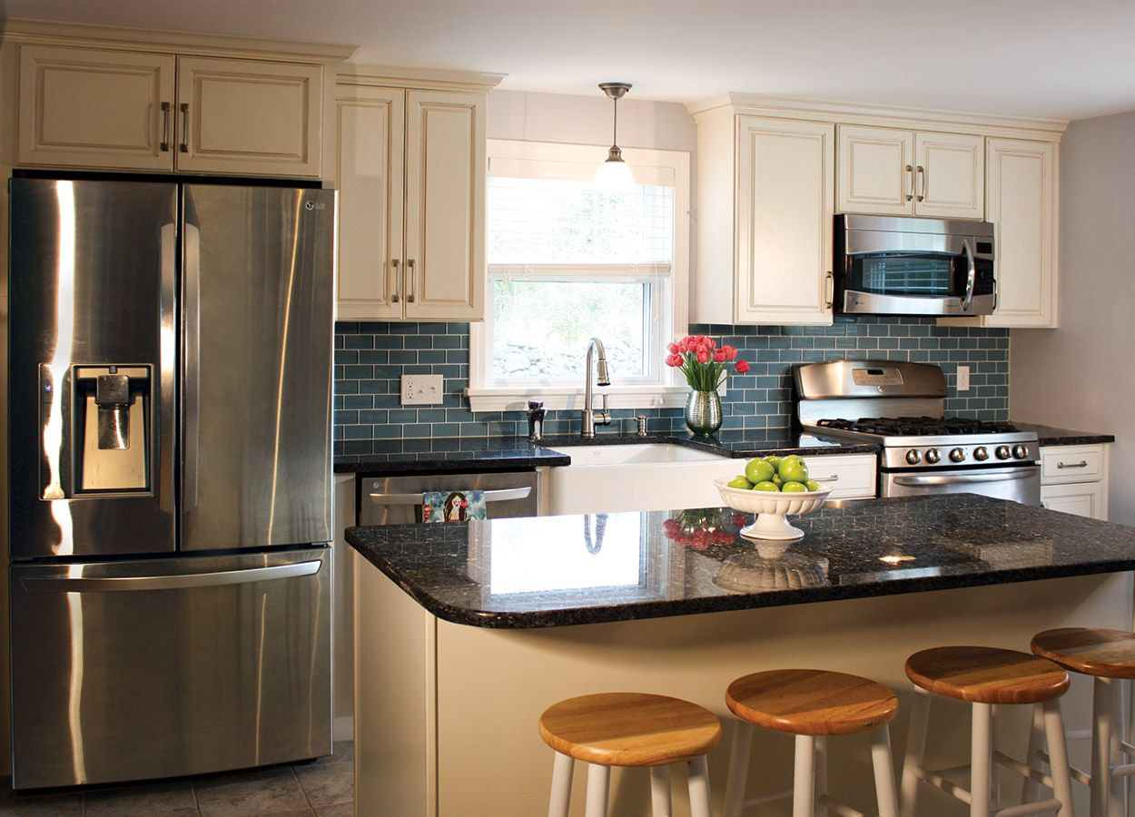 Antique White kitchen with a glaze and Blue Pearl Granite