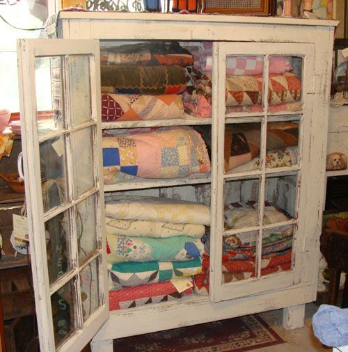 Love Antique Quilts Would Love My Great Grandparents Windows As A Cabinet Front For Either Quilts Or Even As A Buff Quilt Display Vintage Quilts Quilt Storage