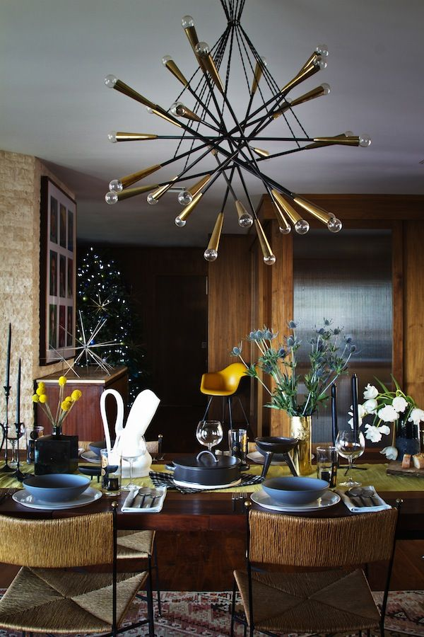 It S A Dark And Moody Holiday Tablescape Mid Century Chandelier Decor Holiday Tablescapes