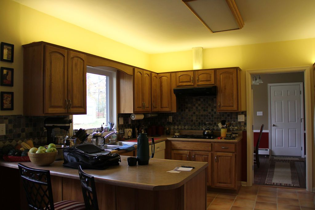 This Kitchen Is A Good Example Of Indirect Lighting Though There Is An Overhead Light On The Ce Indirect Lighting Kitchen Nook Lighting Light Kitchen Cabinets