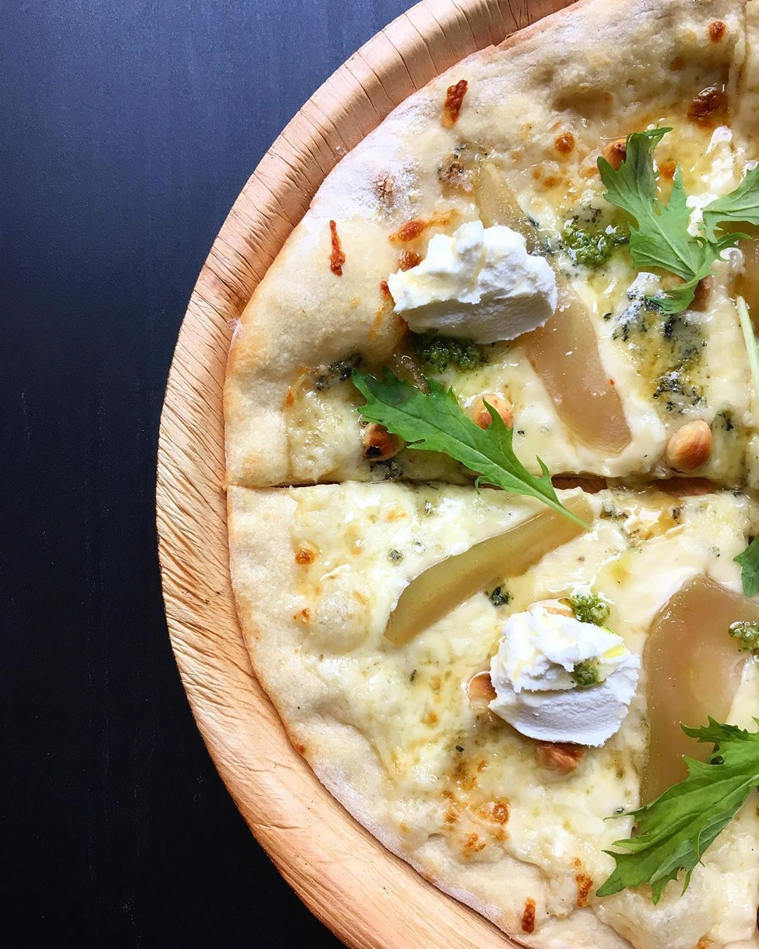 You cannot buy happiness BUT you can buy PIZZA!! 🍕 And that's kind of the same 🤷♂️😁🍕😋🤤 Your looking at our: Goats soft and blue cheese, pickled pear, truffle oil pizza topped with hazelnuts and rocket pesto 🍕 * * *