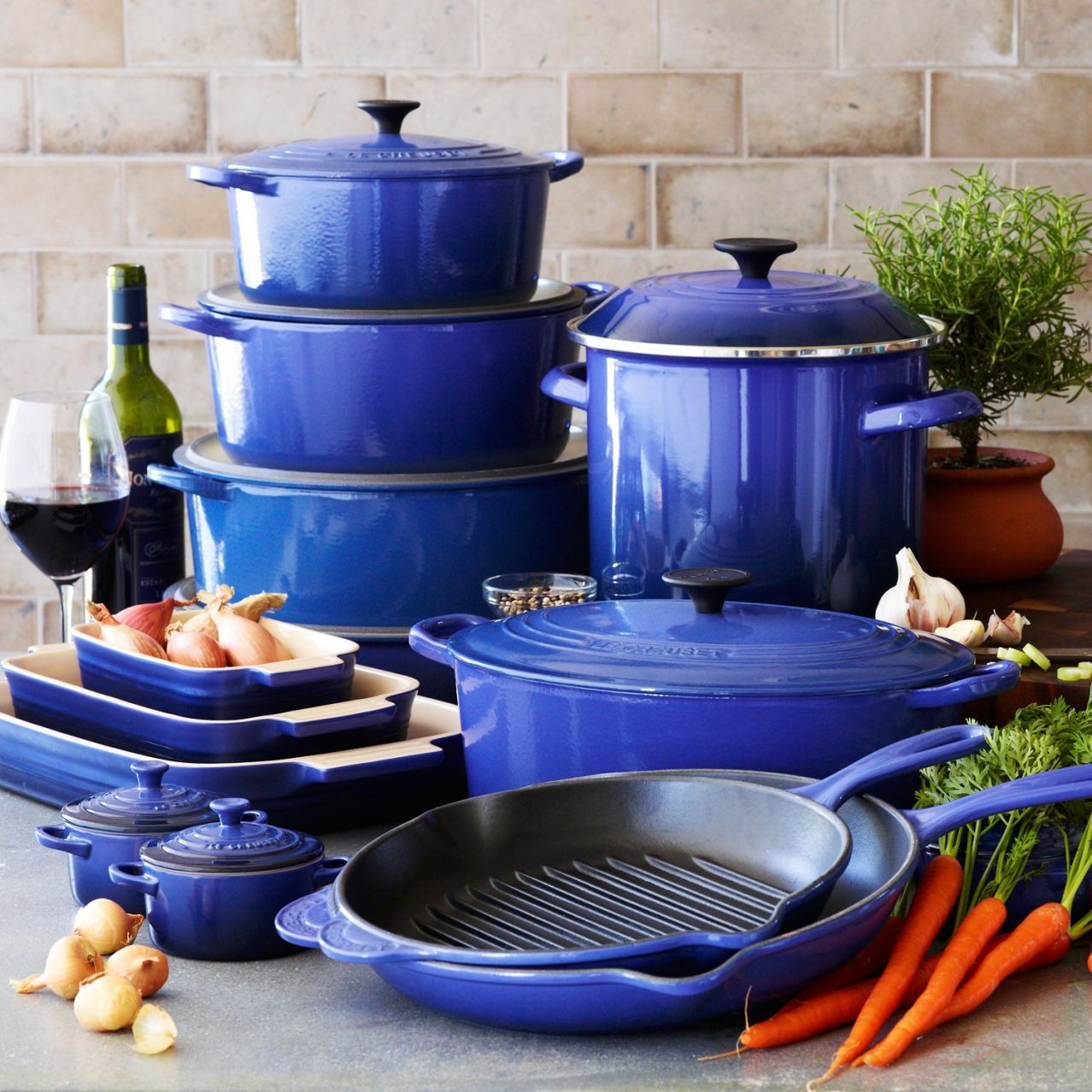 Le Creuset Cobalt! One piece at a time. I want, I want ...