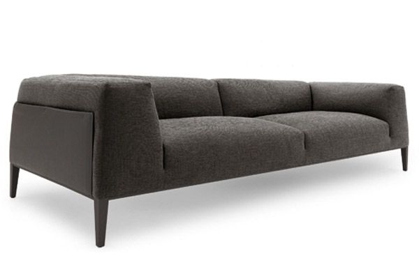 Obsessed with this sleek sofa. Just needs colorful pillows!