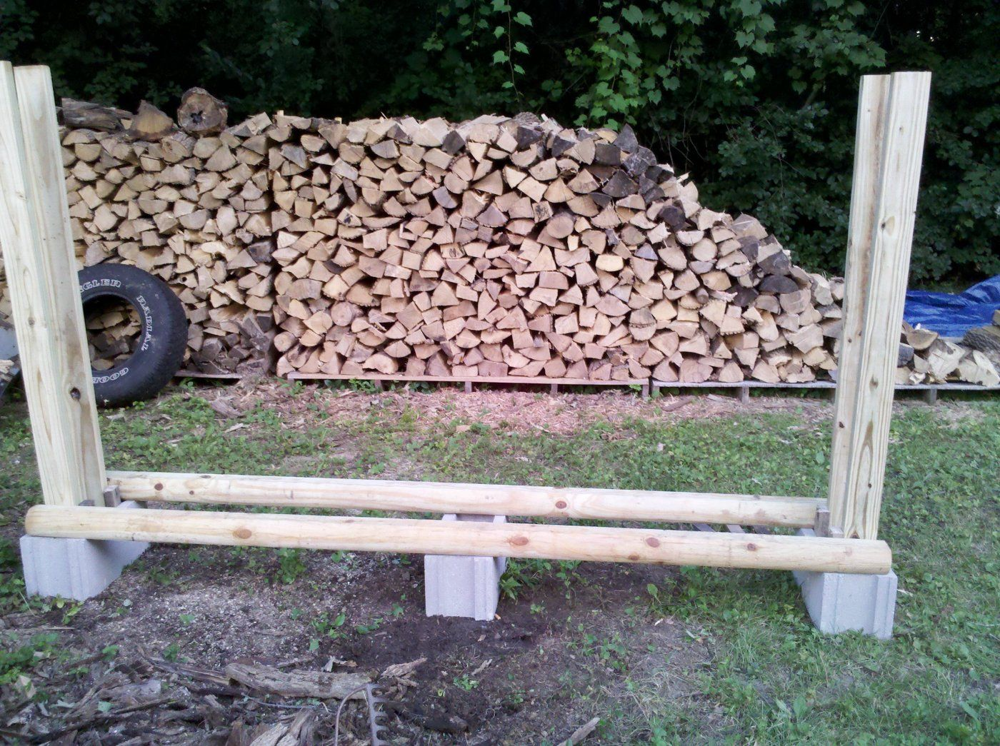 no tool firewood rack just some cinder blocks 2x4s and fence
