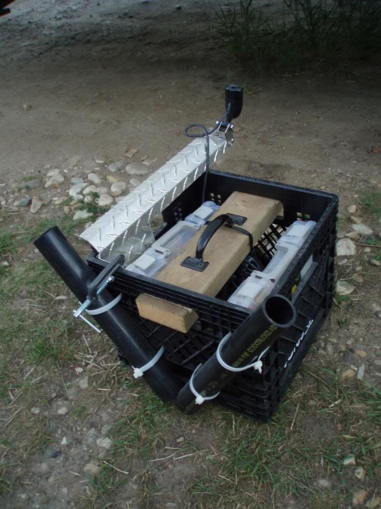 Diy canoe fishing rig a place for poles and storage for Fishing from a canoe