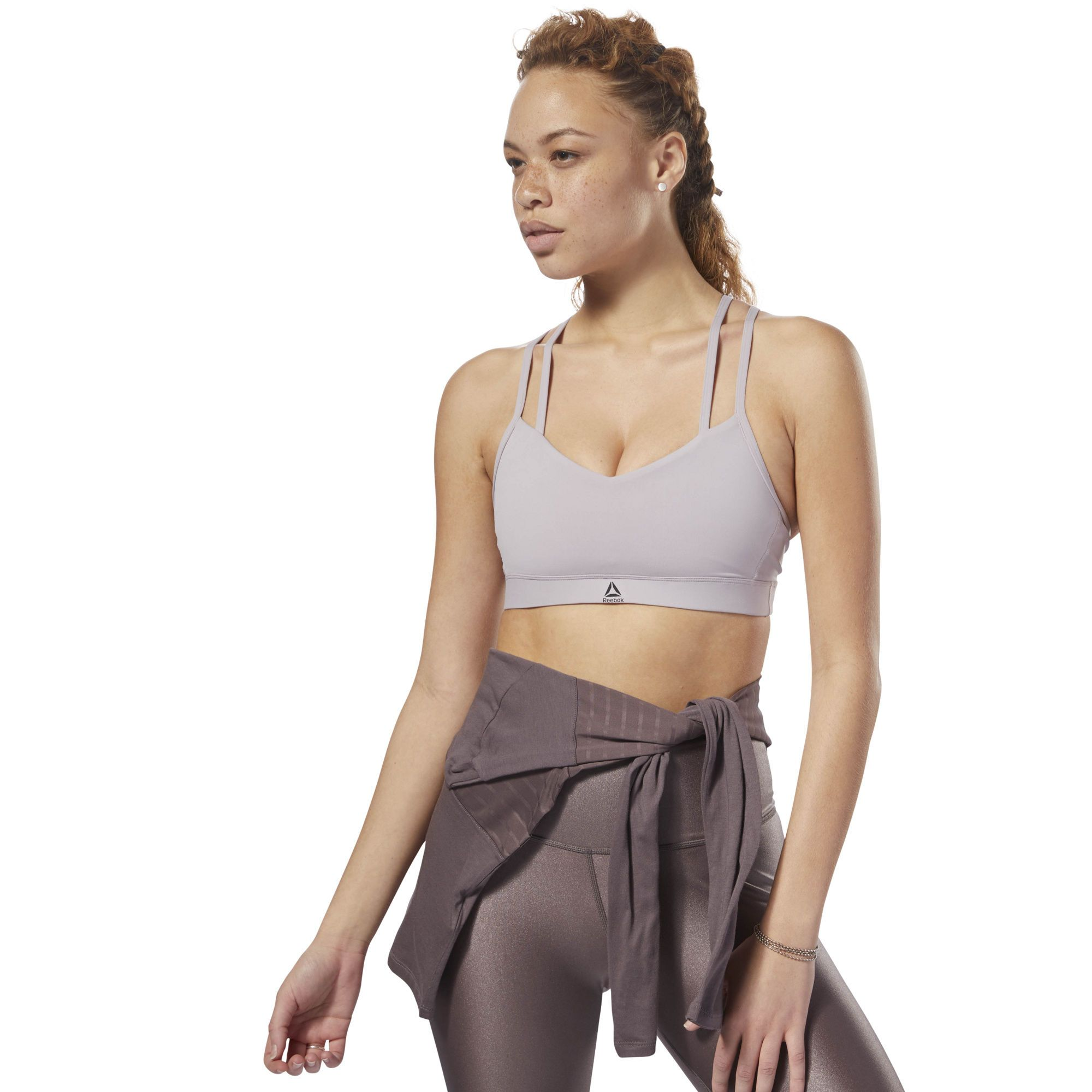 576fe45721 See all the styles and colors of Reebok Hero Strappy Padded Bra - Purple at  the official Reebok US online store.