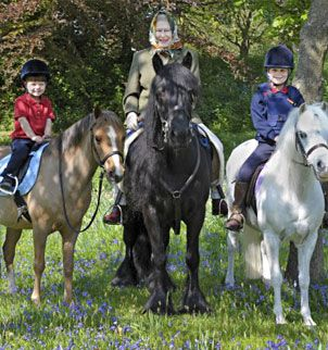 Her Majesty riding with her two youngest grandchildren, Earl and Countess of Wessex's children.