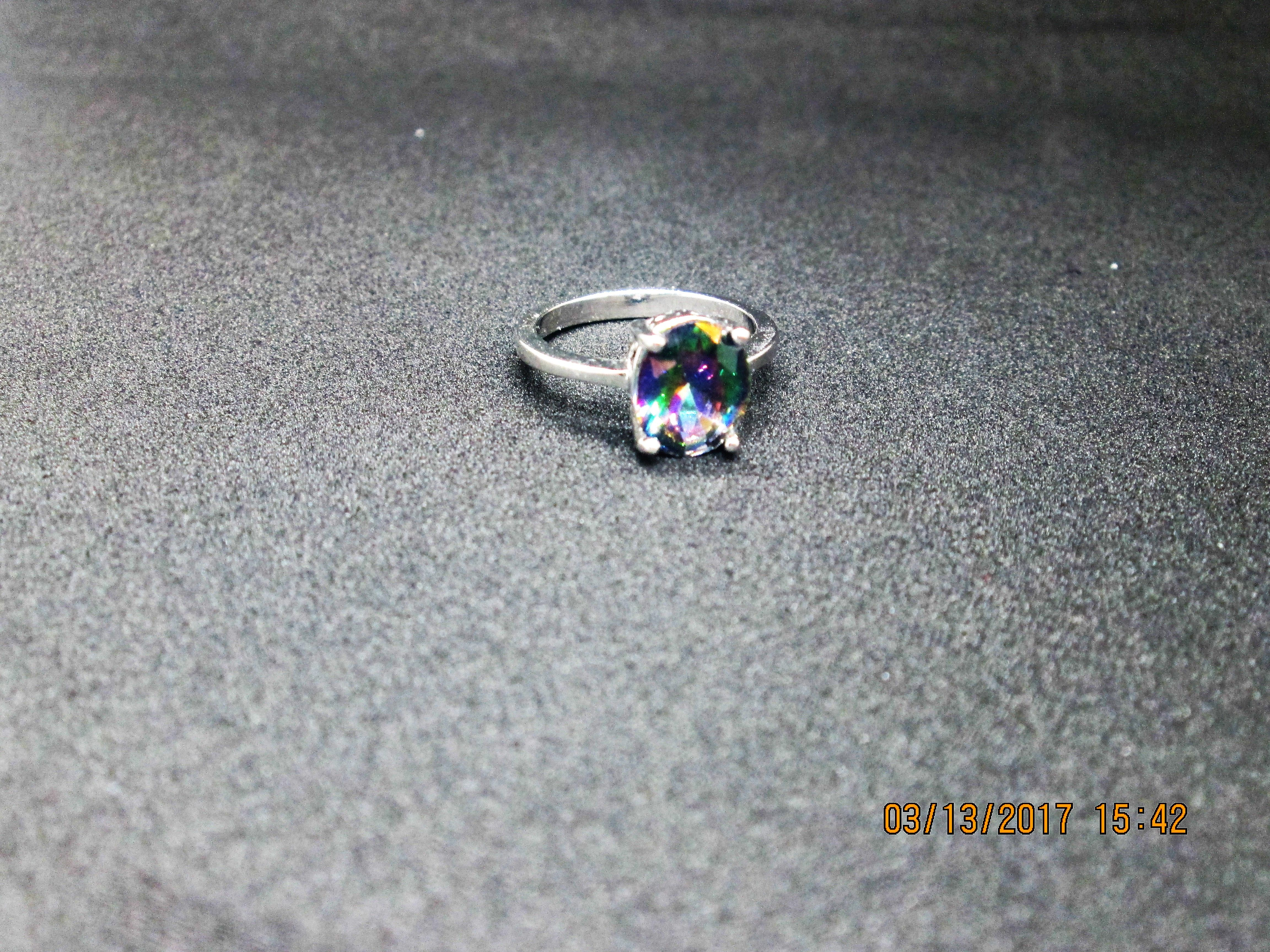 This ring is so pretty! I love how the gem looks different shades of green and purple all at once. The ring is made very well. Super shiny and nice details!  Under 20 bucks! You can't beat that!