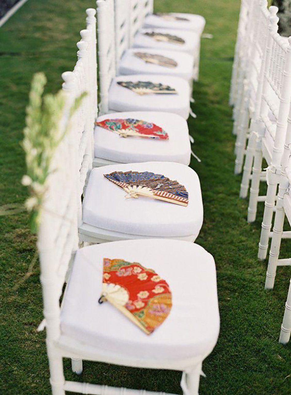 Fans placed on wedding chairs | Asian decor | Pinterest | Fans ...