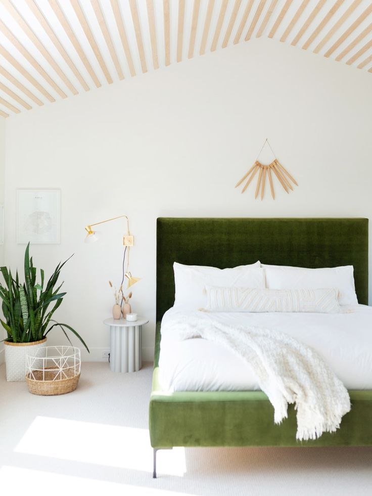 Photo of green velvet bed frame in a minimalist bedroom