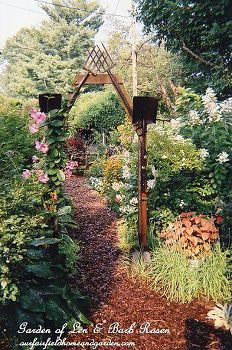 rusty tool arbor, gardening, An inexpensive and unique arbor we built using old garden tools http ourfairfieldhomeandgarden com