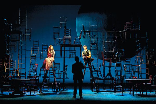 I love this!  I have seen a minimalist set for Our Town but this is even better.  The empty chairs evoke all the other people that inhabit the town.. and graveyear. Beautiful set  - Williamstown Theatre Festival's Our Town. DBK