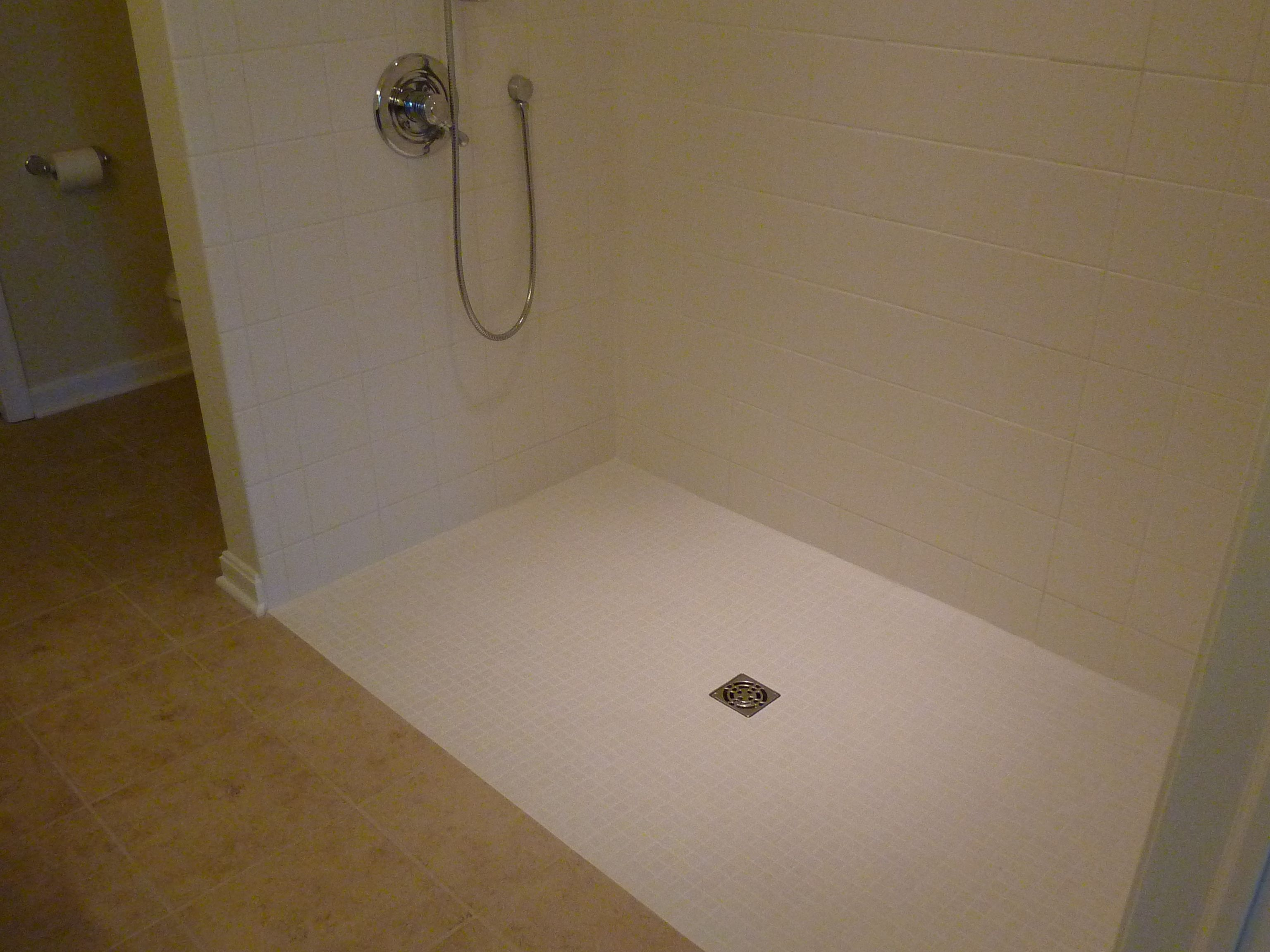 Roll in tile shower. A tub was removed and the new shower floor is ...