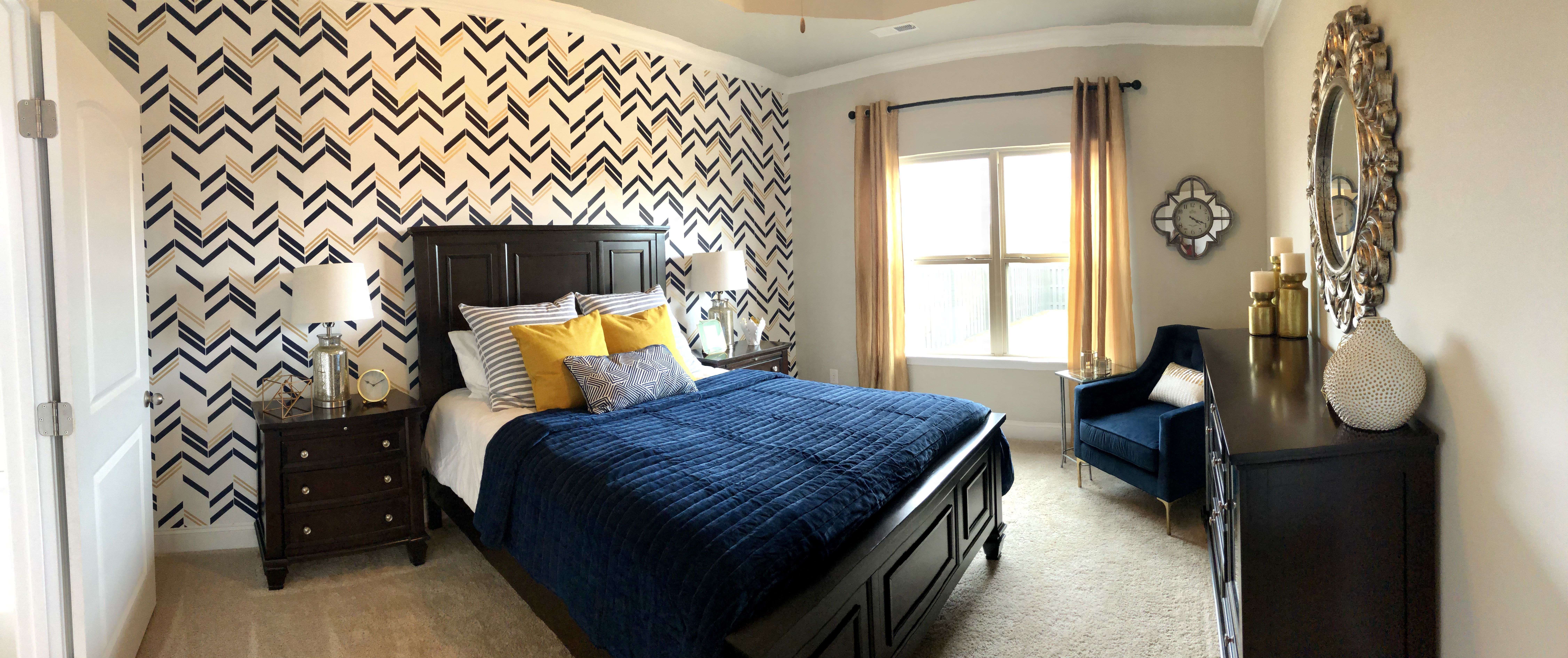 Funky and bright master bedroom with navy and white