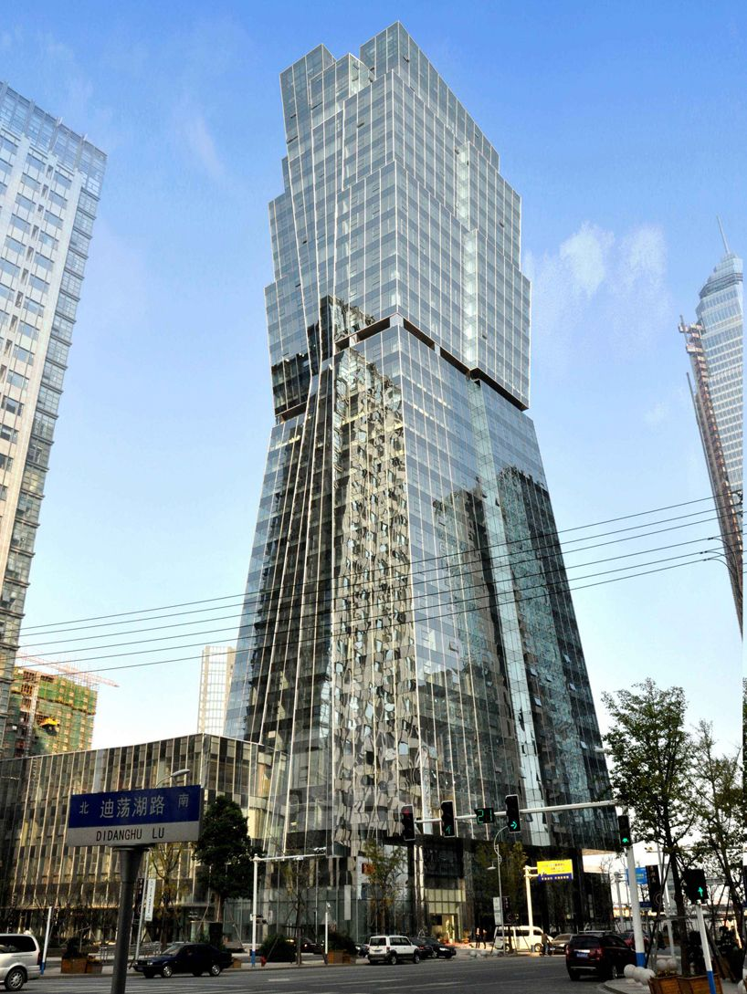 Liu xisang slopes multilayered shaoxing city tower in for Arquitectura china moderna