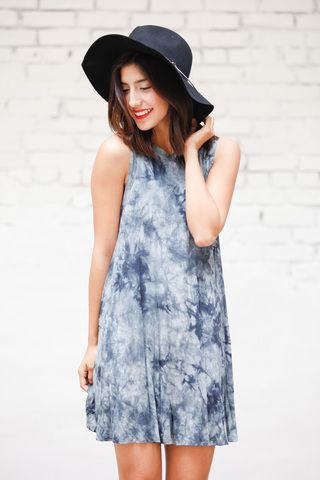 The Mermaid Motel Tie Dye Dress features a muscle tee cut, various tie dye patterns, and a comfortable fit.
