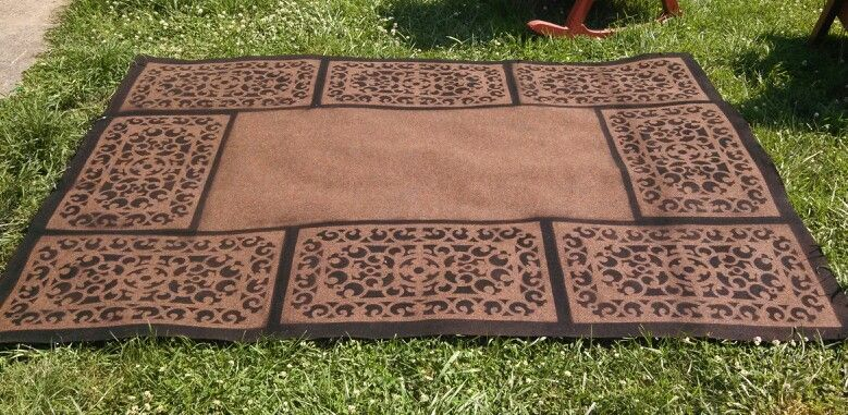 Persian style rug: created using a plain $12 6x8 rug, a wrought iron style rubber mat, and spray paint! Simply place the mat where you want the design and spray! So easy! This would also work great with a stencil. Perfect for Pennsic!