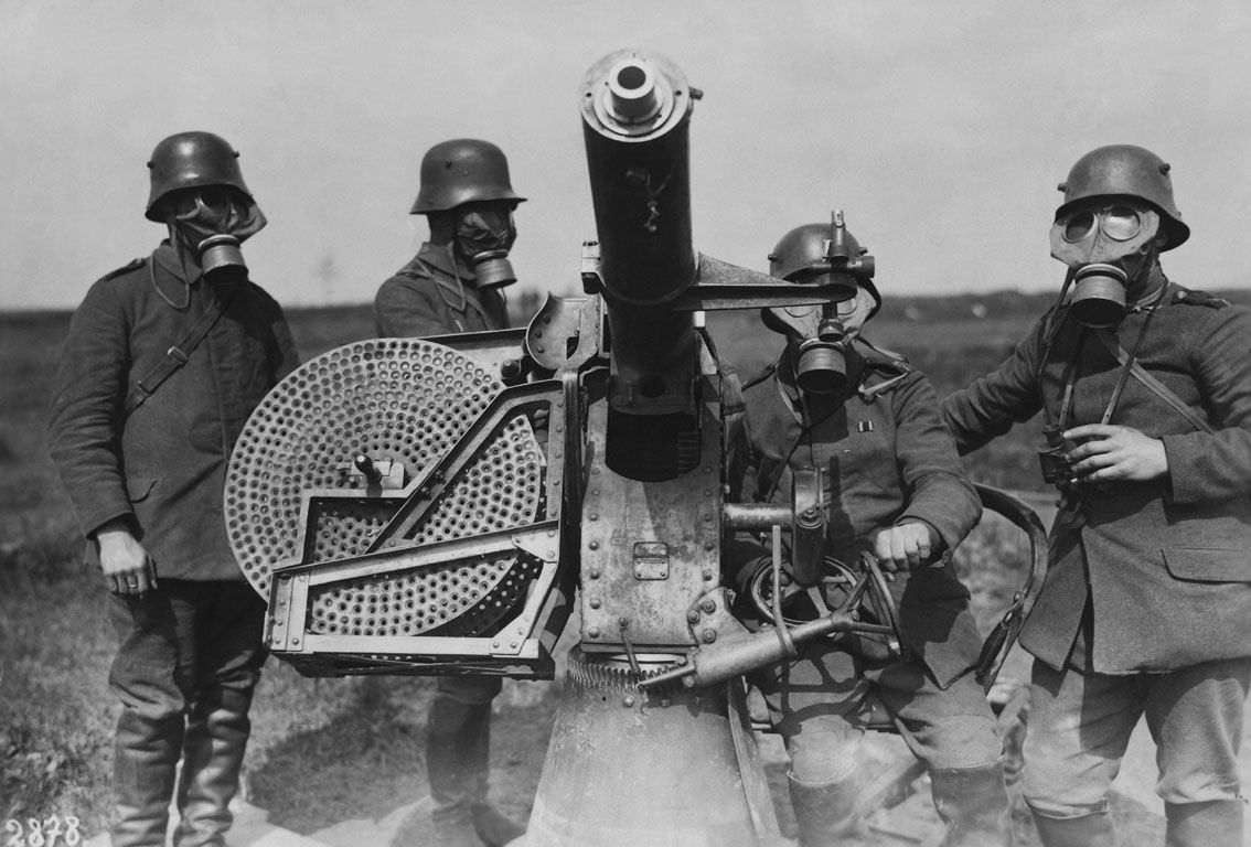 Germans wearing gas masks and Maxim Flak M14 anti aircraft gun