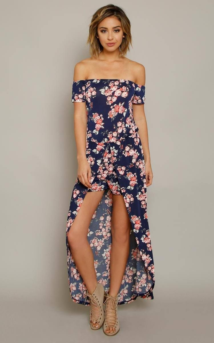 61c8a0d9a26 Off the shoulder knit maxi romper featuring an elastic bustline and short  sleeves. Accentuated elastic waistline and floral print throughout.
