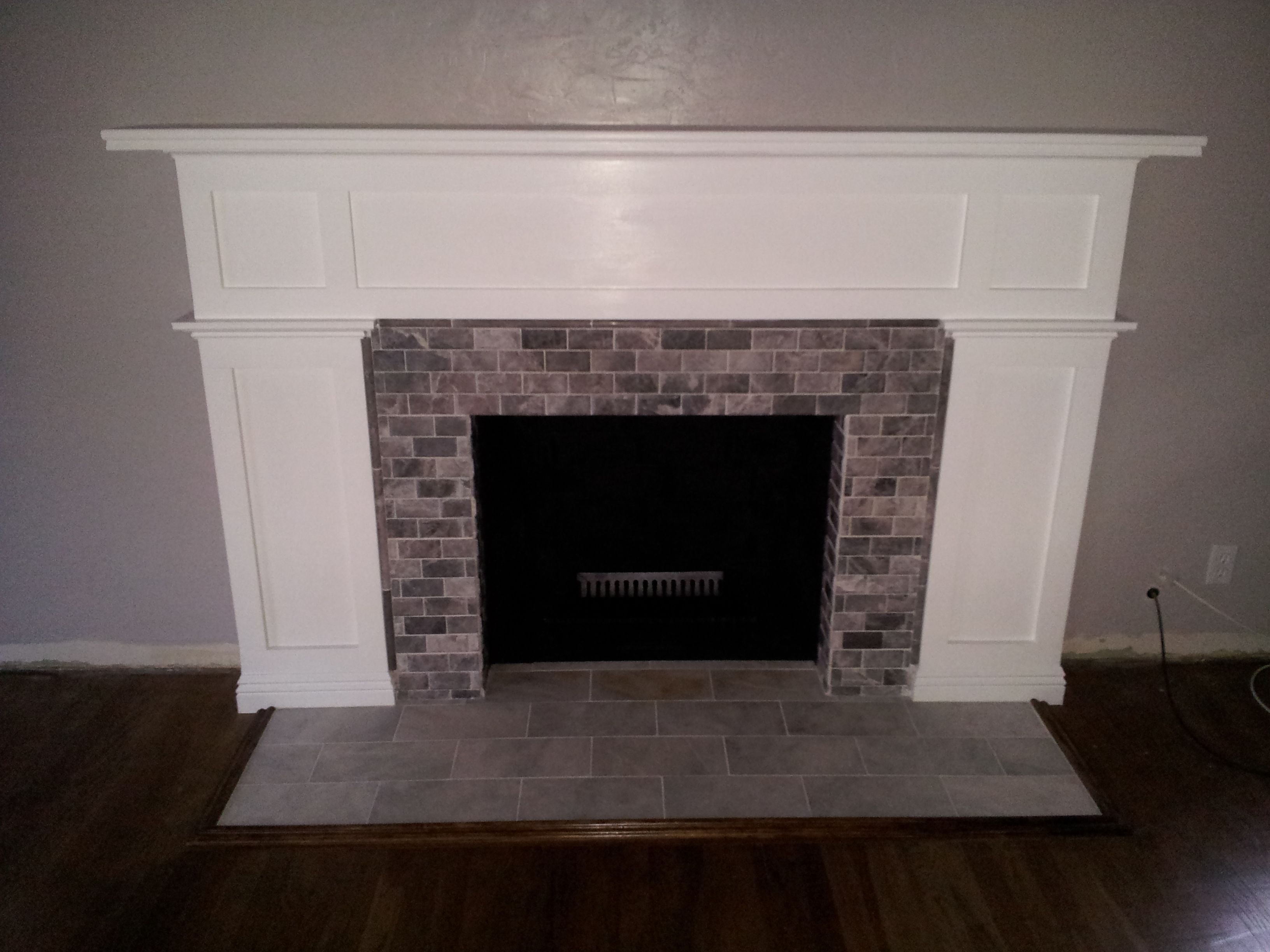 firebox painted black and room painted grey fireplace remodel