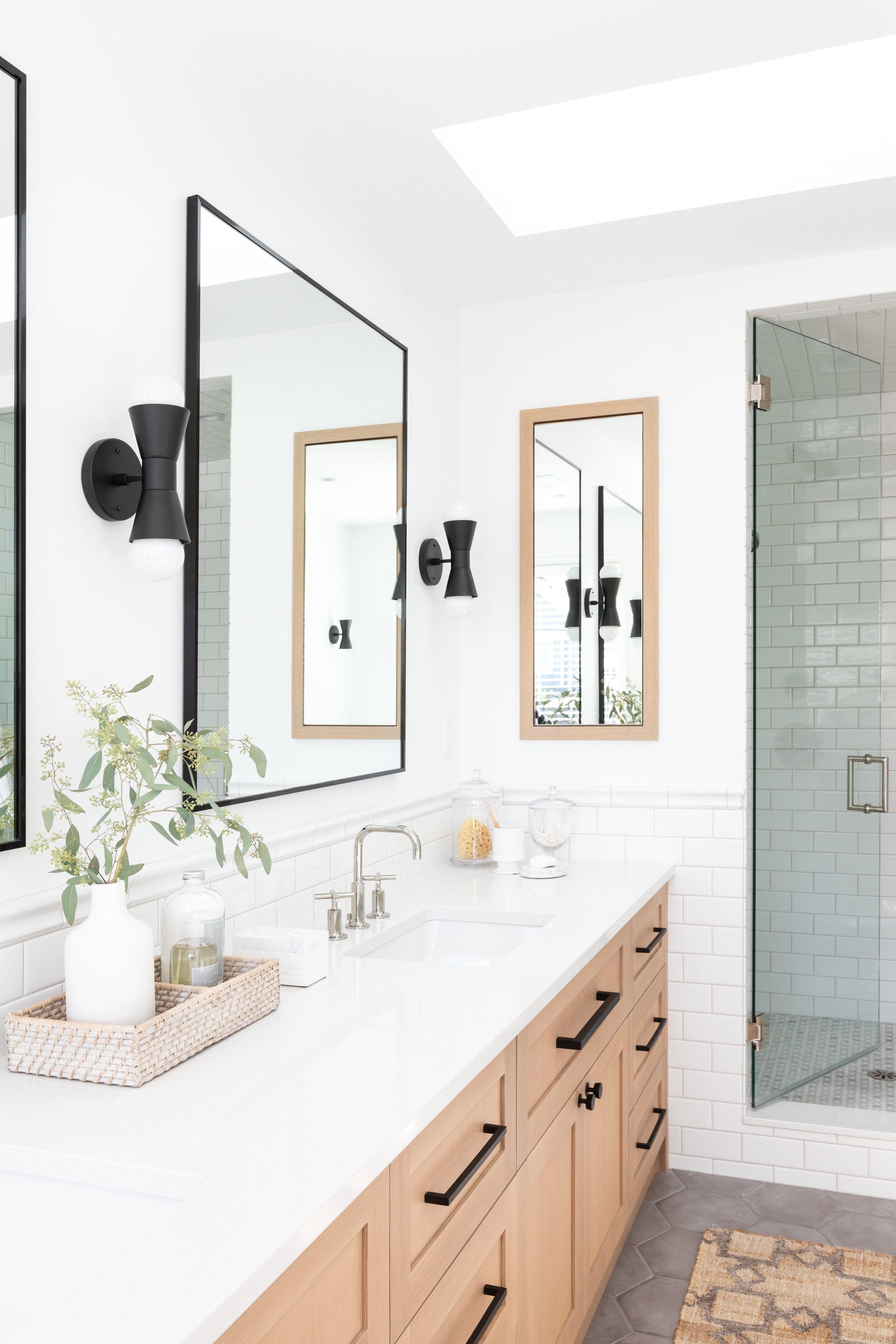 White Bathroom Bathroom With Brack Mirrors And Lighting Wood Vanity And White Countertops Black Har Bathroom Design Minimalist Bathroom Wood Bathroom Vanity