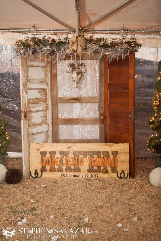 Rustic country wedding alter with handmade wooden sign.
