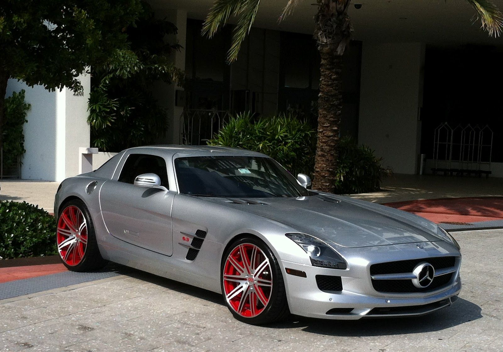 Silver gray mercedes benz sls with red custom rims for Mercedes benz custom cars