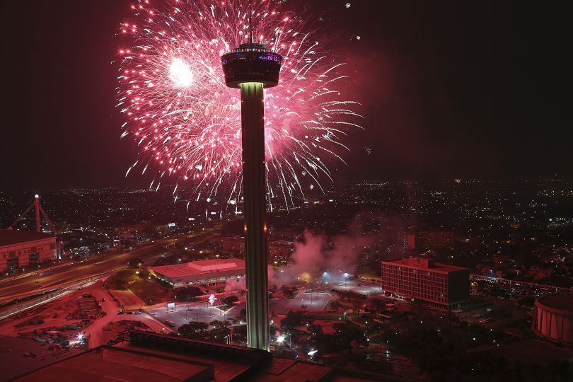 Fireworks explode over Hemisfair Park and the Tower of the