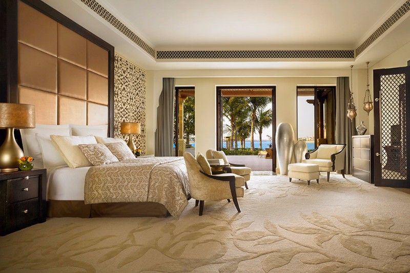 an elegant hotel room design in cream and gold with