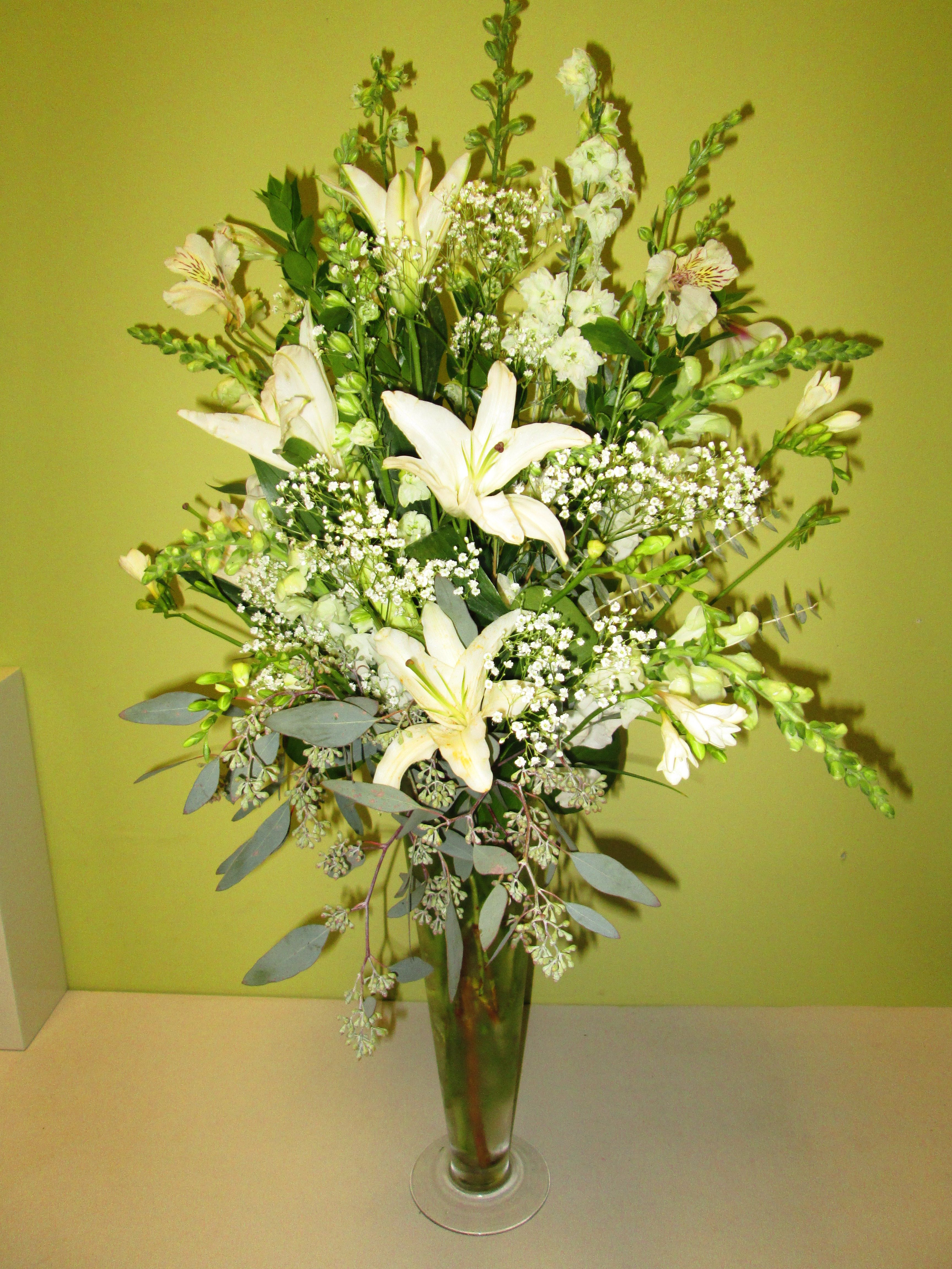 All White Vase Arrangement Featuring Oriental Lilies And A Variety