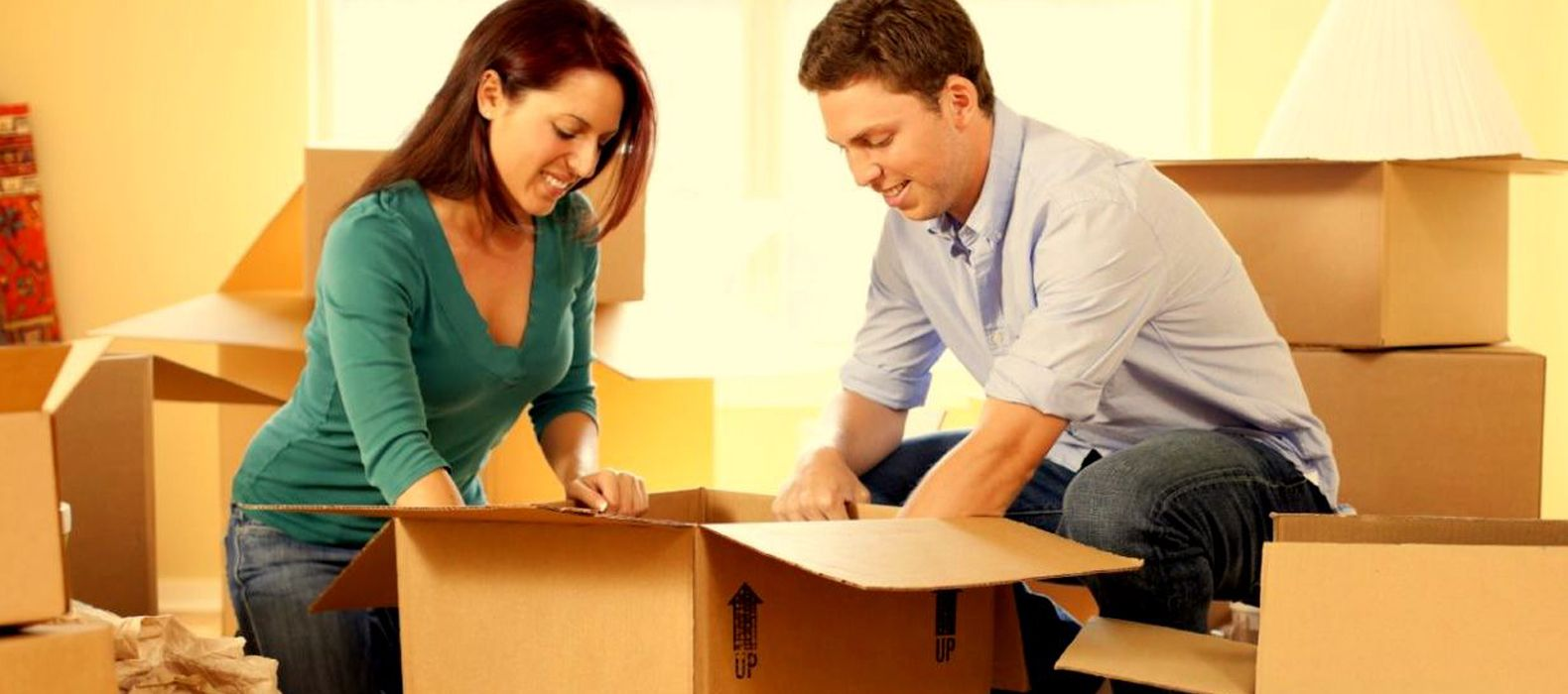 man and woman putting items in boxes