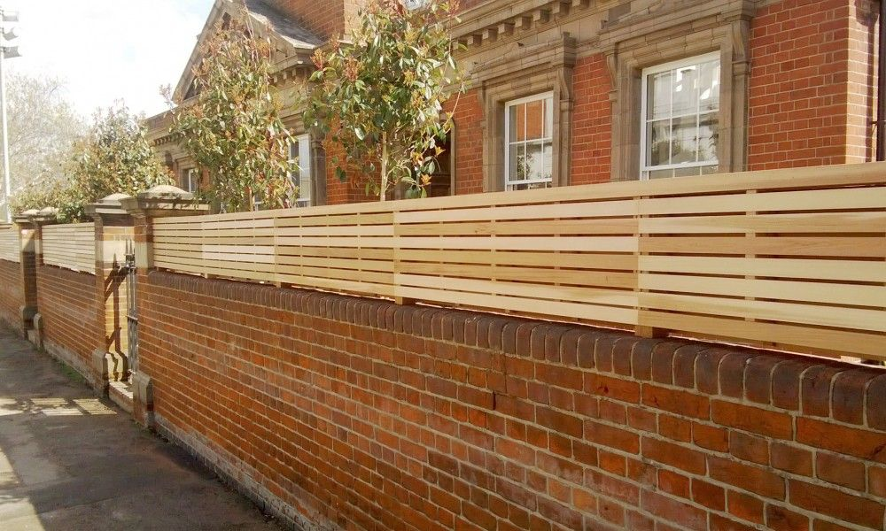 Western Red Cedar Panels Ona Brick Wall Brick Fence