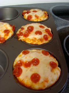 Cupcake Pizzas ... better than bagel bites!  What You Need: Pillsbury Refrigerated Pizza Dough Pizza Sauce Shredded Cheese Pepperoni Cupcake Tin (I used a muffin tin so the pizzas were bigger)  Directions: Preheat oven to 425 degrees (as the package directed) and grease the cupcake pan. I separated the dough into 4 equal parts; there wasn't enough to do more but maybe you could get 6 in cupcake pan. Push the dough into the molds; try to make the dough cover the sides.  Cover dough with pizza…