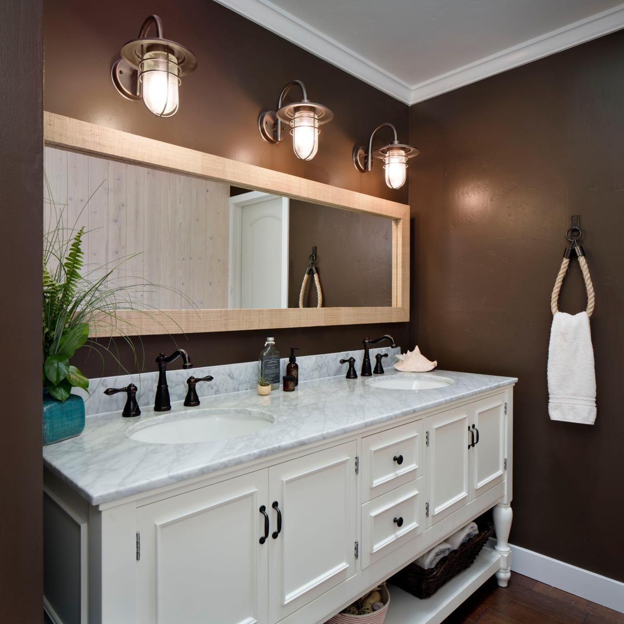 chocolate brown walls in traditional bathroom with white vanity and gray marble countertop hgtv - Bathroom Ideas Brown And White