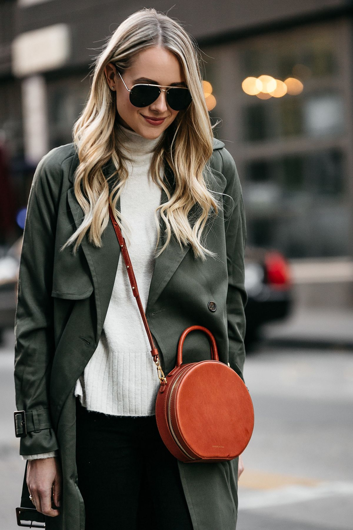 16fd24b2ae38 Blonde Woman Wearing Green Trench Coat White Sweater Mansur Gavriel Circle  Crossbody Fashion Jackson Dallas Blogger Fashion Blogger Street Style