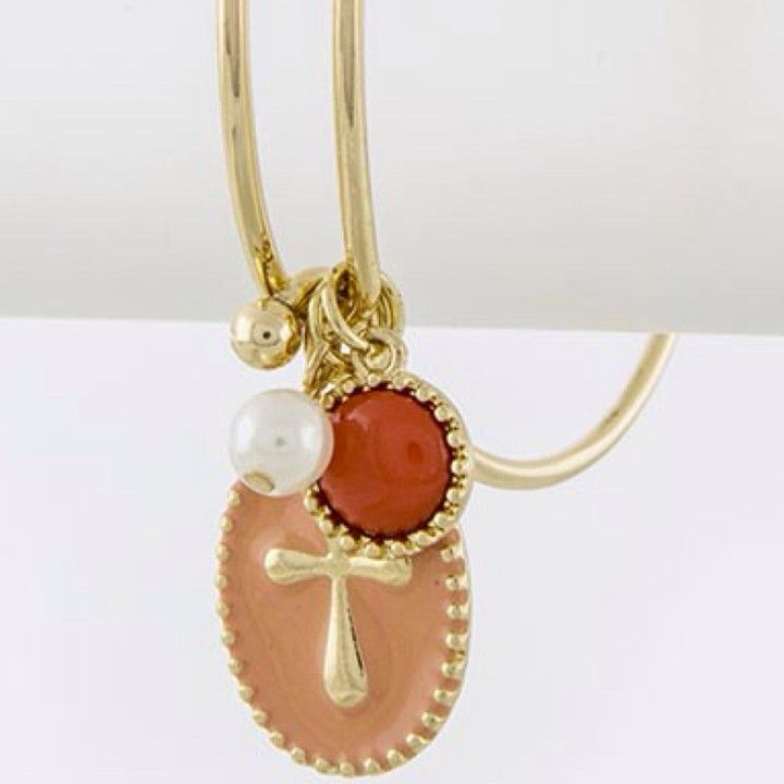 Peach Cross Bangle Bracelet from Morties Boutique for $7.95 on Square Market