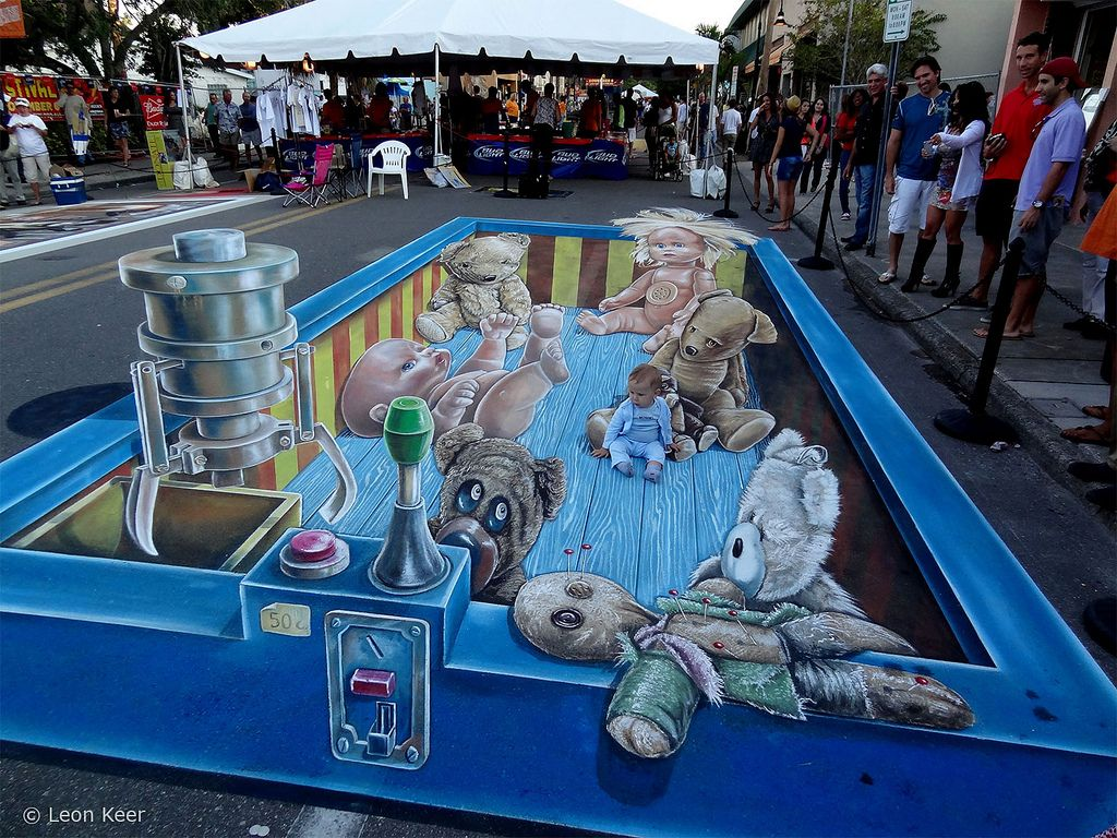 https://flic.kr/p/dqCtsa | 3d-street-art-sarasota | 3D street art at International Chalkfestival Sarasota Florida. Created by Leon Keer. The image shows a grabbing machine with a box of teddybears and dolls waiting to be grabbed. The image is a metaphor for the forgotten playfulness in life, never forget to explore your creativity by keeping your inner child close.