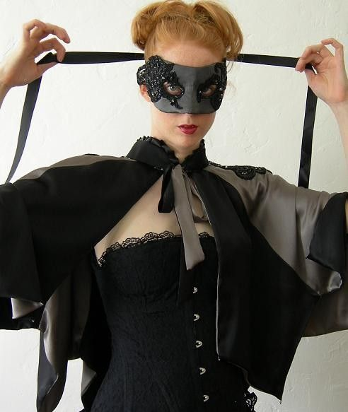 Midnight magic - Black and Silver Capelet with bejeweled black lace epaulettes.