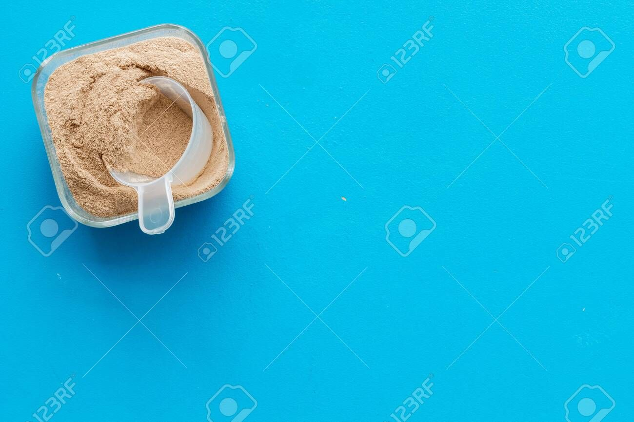 Protein powder for fitness nutrition on blue background top view mock-up Stock Photo , #AD, #nutriti...
