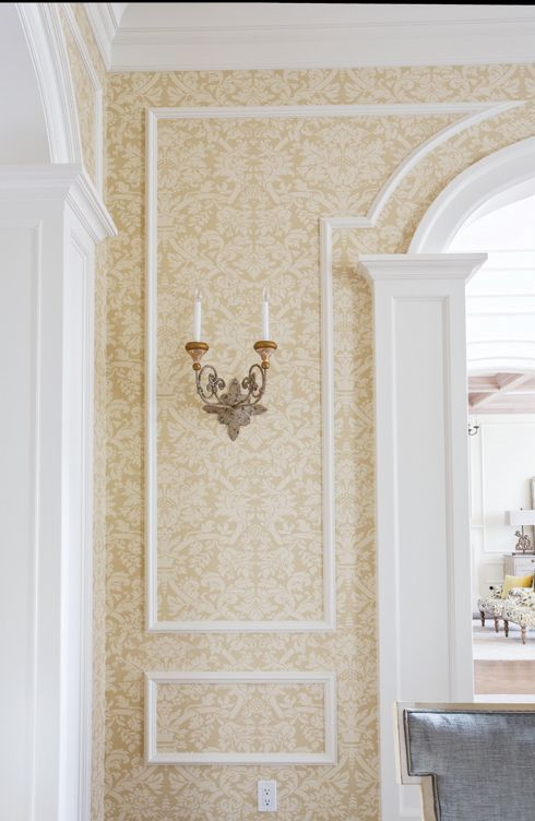 Breaking Tradition: Thibaut wallcovering and a shapely molding treatment beautifully dress a dining room wall.