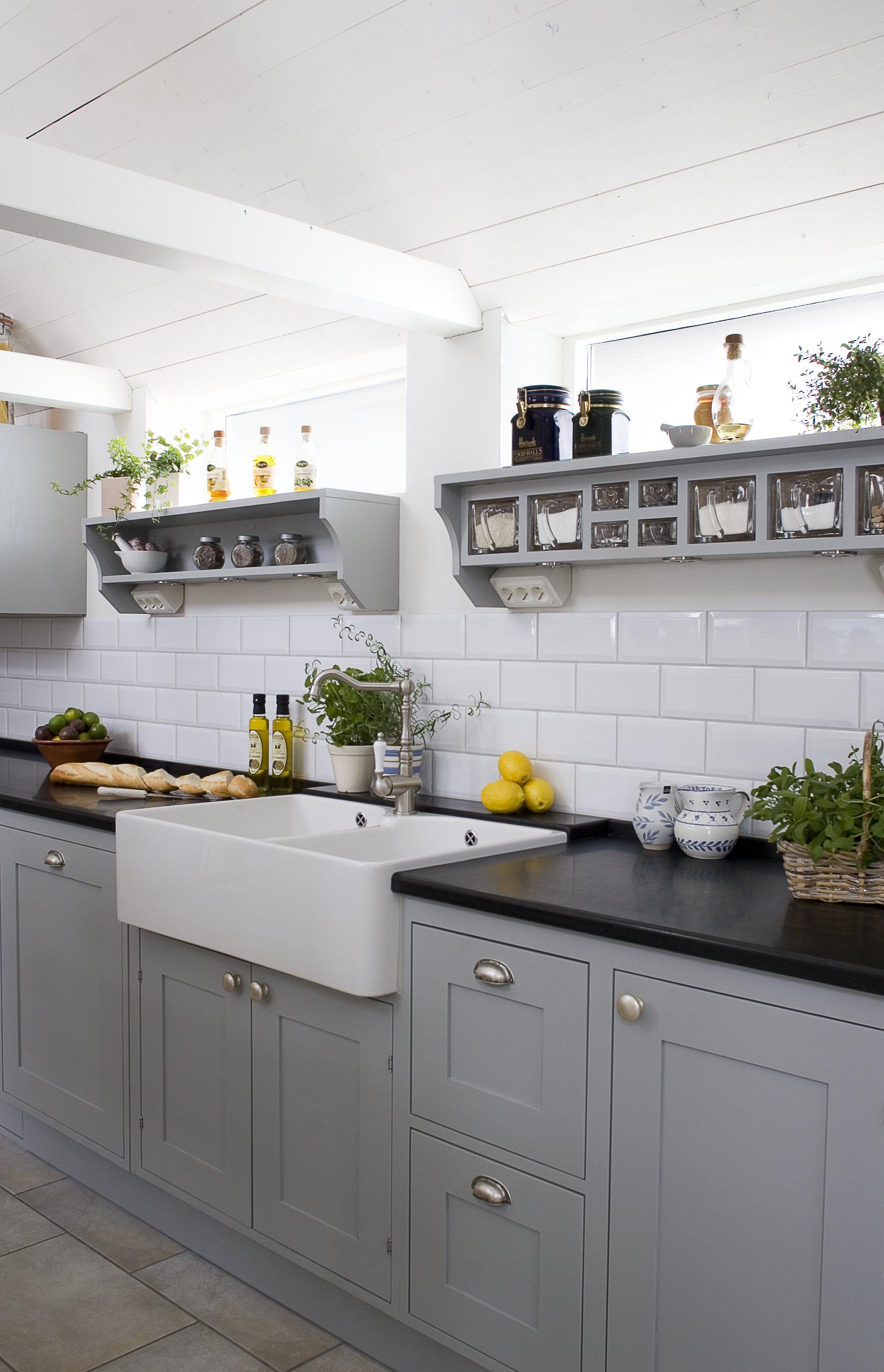 Kitchen in Grey, notice the famous Swedish glass jars in the shelf #Scandinavianstyle #Greykitchen #Glassjar #SolaKitchens