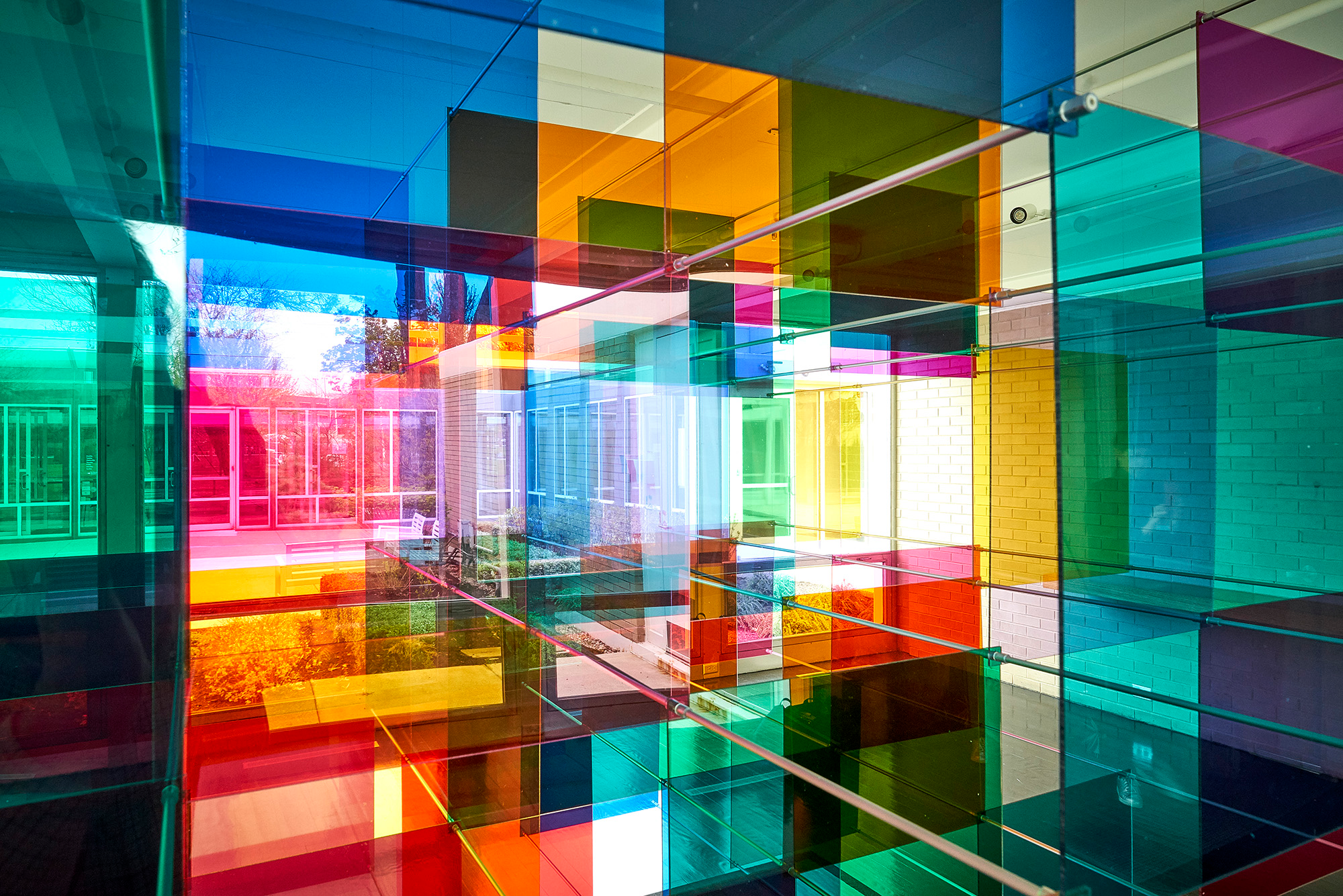 Light Shines Through a Rainbow-Tinted Geometric Panel Installation by Art Duo Luftwerk