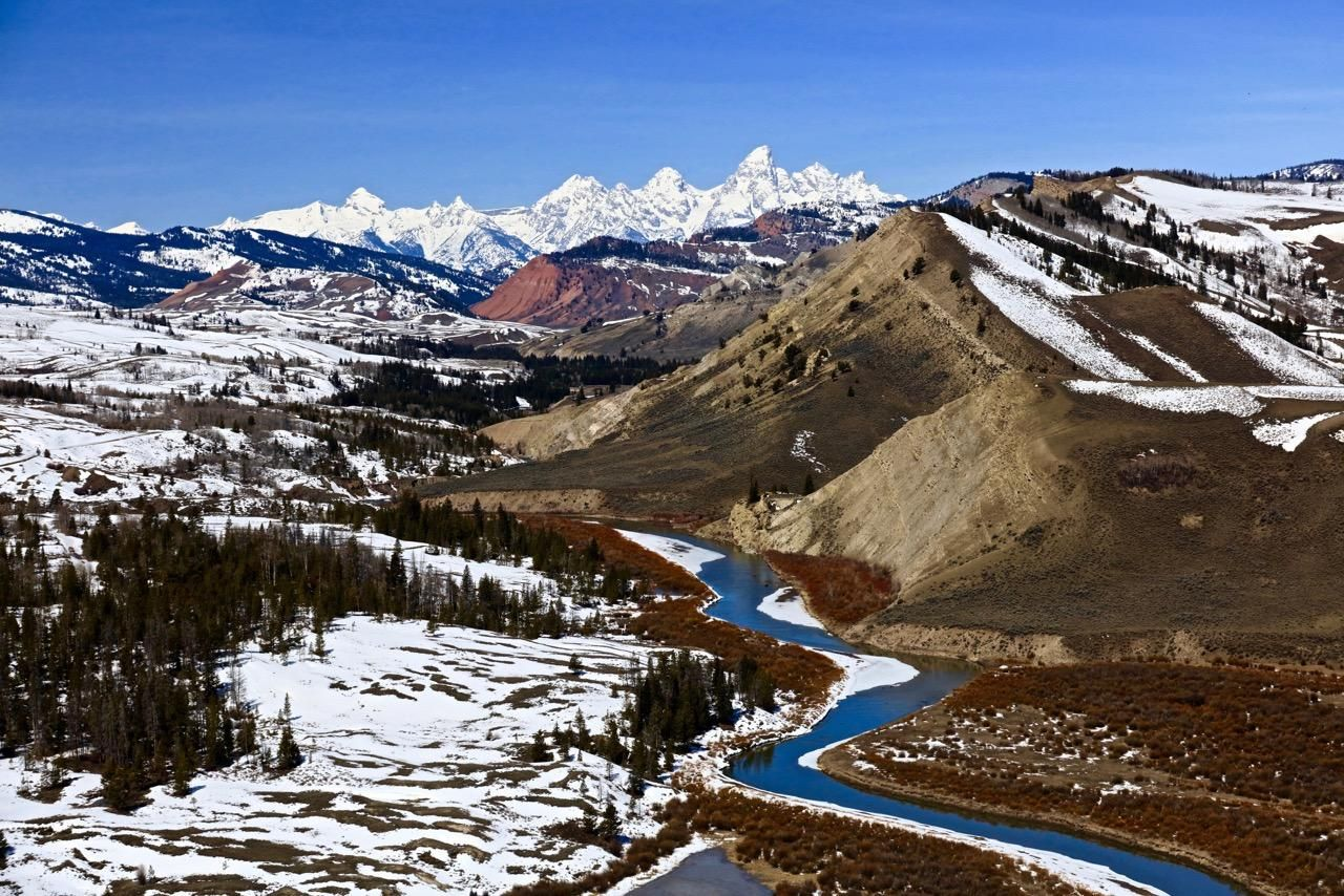 """4/7/16- THE """"GROS VENTRE""""  WILDERNESS AREA IN WYOMING ,LOOKING TO THE WEST AT THE GRAND TETONS ON OUR WAY TO DRIGGS, IDAHO TO REFUEL THE HELICOPTER  WE WERE IN OVER YELLOWSTONE"""